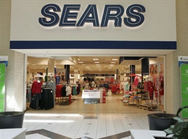 Earns Sears Holdings