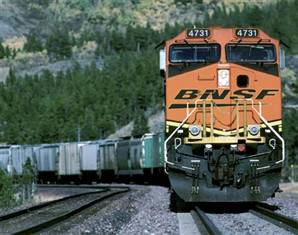 Warren Buffet hedges his bet on America's future, buys the BNSF.